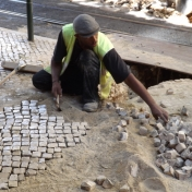 Resetting cobblestones after utility work